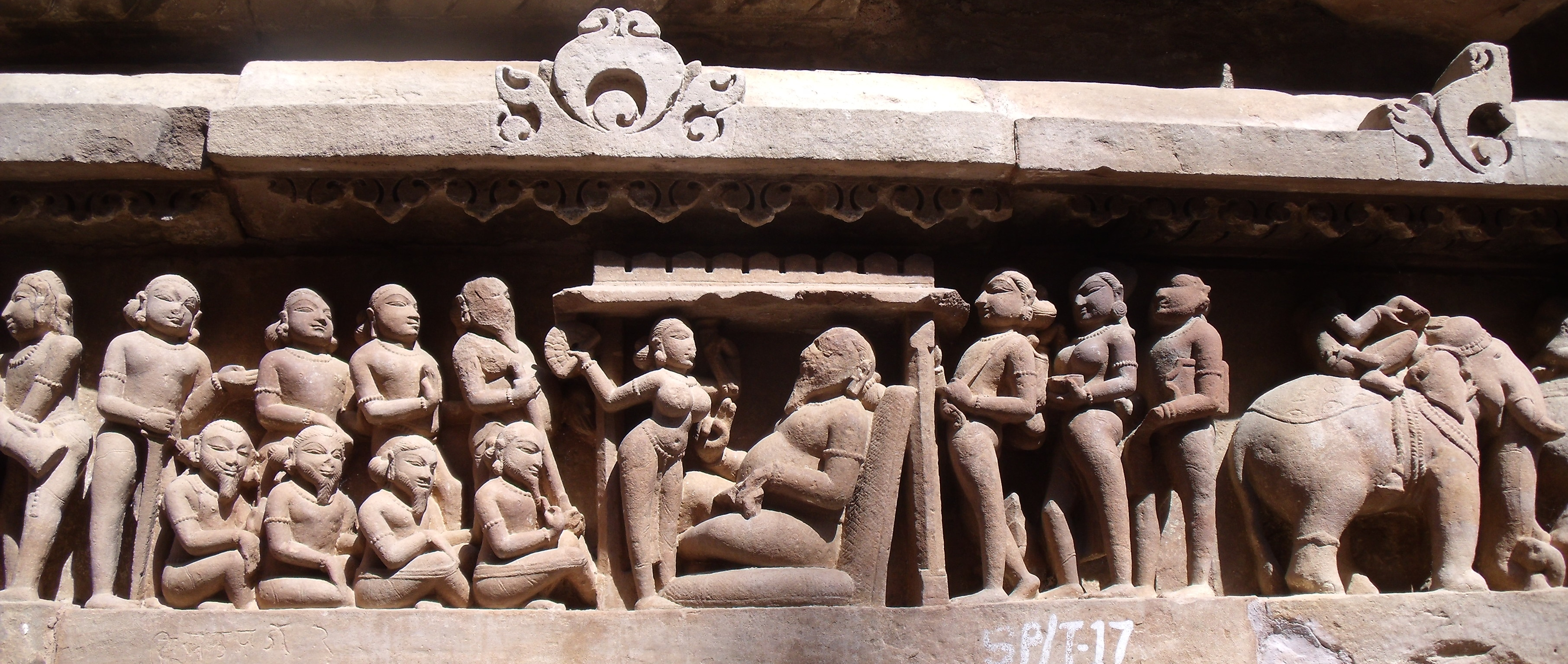 Khajuraho. High reliefs on base of temple.